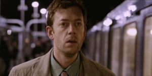 a man looks for love near a train